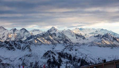 Kitzsteinhorn dark mood weather sky snowy mountainscape landscape winter. blue hour light glimmering. perfect light and sky.