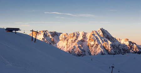 sunset view steinernes meer Saalbach hinterglemm leogang with mountains in sunset light. Perfect blue and red sky. Peak station chairlift in front of the mountains. Reklamní fotografie