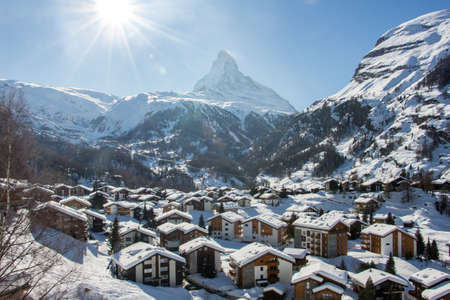 Perfect view of Zermatt and the Matterhorn and surrounding mountains sun view, with blue sky and perfect light. The snowy Swiss mountains and landscape in winter is extraordinary. After a long skiing day these views are incredible.