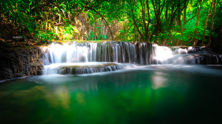 Huai Mae Khamin Waterfall, Kanchanaburi It is a beautiful waterfall in Thailand. And people go on vacation. Or take family to create activities together.