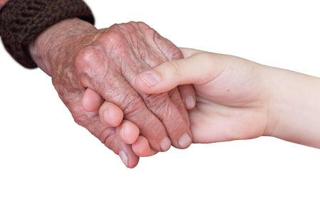 charity work: young and old hand on a white background Stock Photo