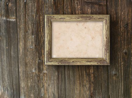 Old frame on a wooden background  photo