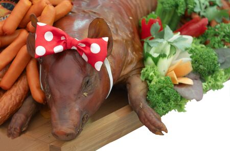 roasted pig with vegetables photo