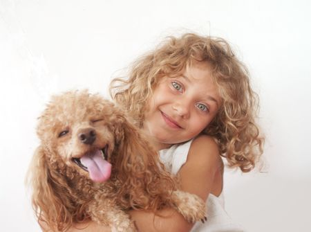 Young girl with her toy Poodle  Stock Photo
