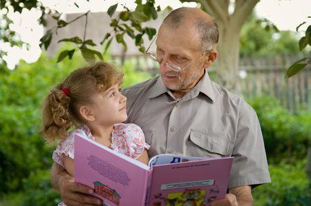 grandpa reads a fairy tale photo