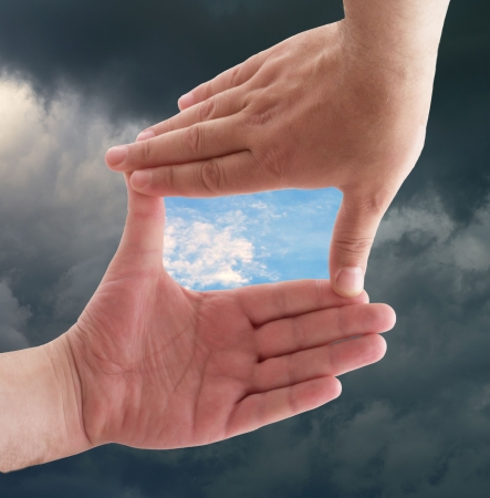 two visions: hands against a background of sky Stock Photo