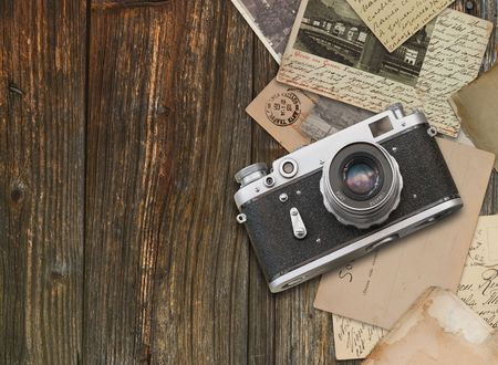 film camera: Vintage camera on wooden background