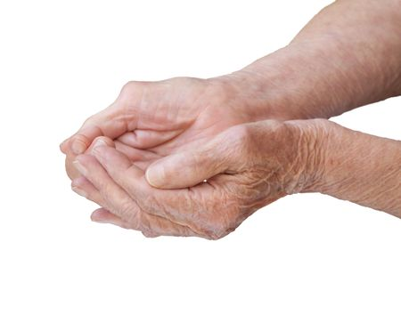 old beggar: The old womans hands folded in a handful of white background  Stock Photo