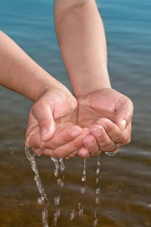 sea pollution: hands of the water drop