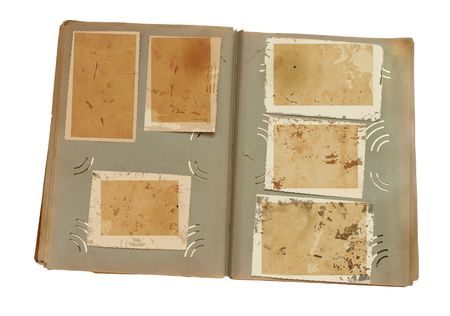 photo album page: Vintage photo album with blanked photos on old wooden texture