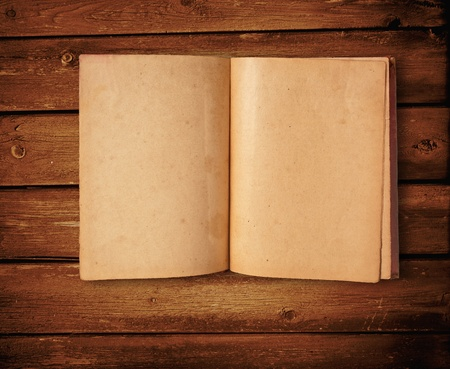 Old book Open two face on wood  Standard-Bild