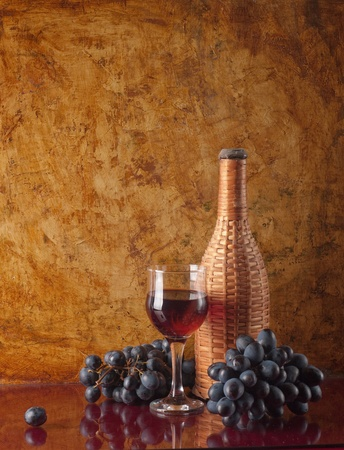 bottle with red wine and glass  photo