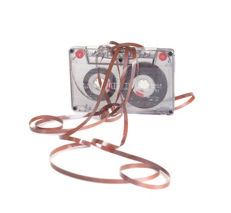 pulled over: Transparent audio cassette with pulled out tape over white background  Stock Photo