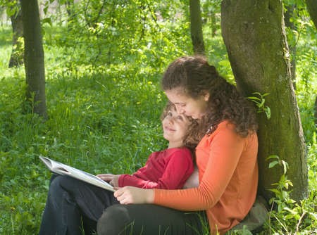 Mother and Daughter reading the Book in a park.Education concept  Stock Photo - 9506940