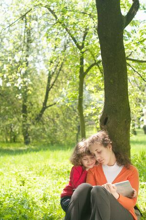 Mother and Daughter reading the Book in a park.Education concept Stock Photo - 9506924