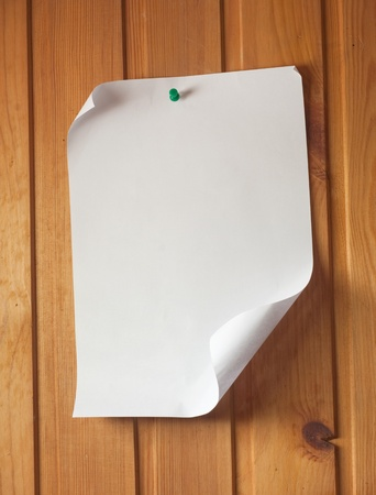 piece of blank paper tacked to wooden background.Ready for your text