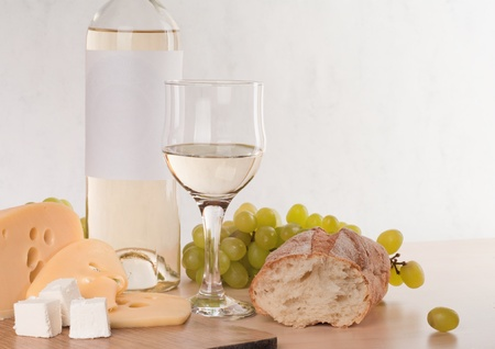 Still-life with bunch of grapes and white wine  photo