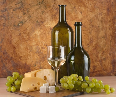 white wine with different sorts of cheese  photo