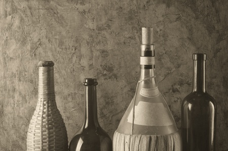 liqueur labels: different bottles on the background of the old wall  Stock Photo