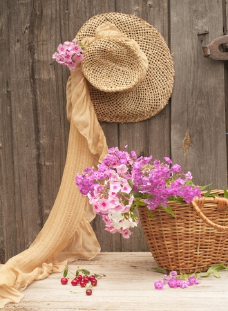hanging flowers: Rustic image of a gardener