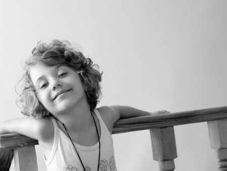 Cute pretty blonde preschool girl child smiling in black and white Stock Photo - 10600090