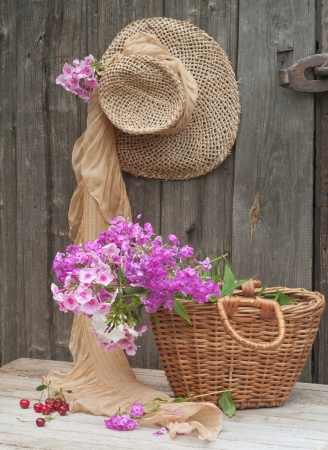 Rustic image of a gardener's straw hat and basket  Stock Photo - 10600132