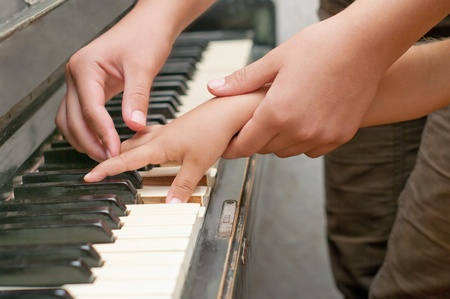 teacher and childs hands touch keyboard  Stock Photo