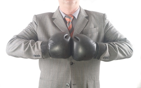 aggressiveness: Businessman with boxing gloves. Concept: competition, aggressiveness.