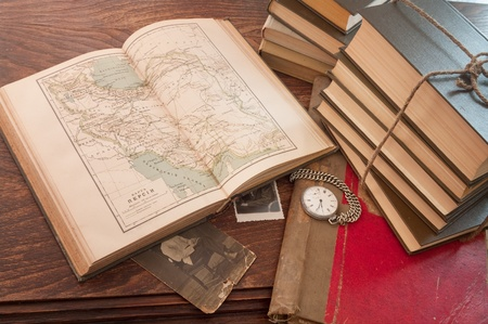 antique background with the old map and a clock on a wooden table Stock Photo - 10600144