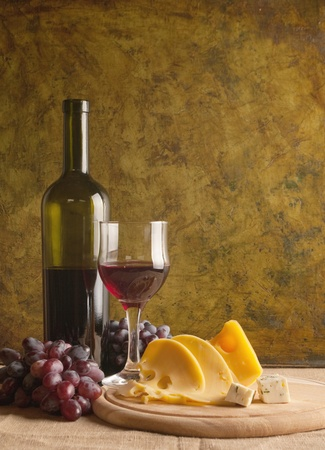 Red wine glass on vintage a background  photo