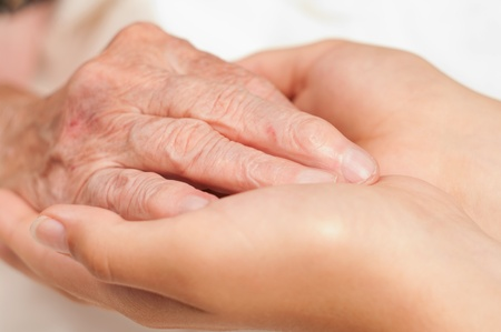 Aging woman: Old and young hands.