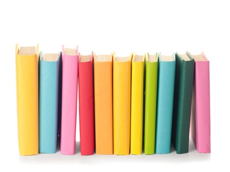 bookshelves: close up of stack of colorful books on white background
