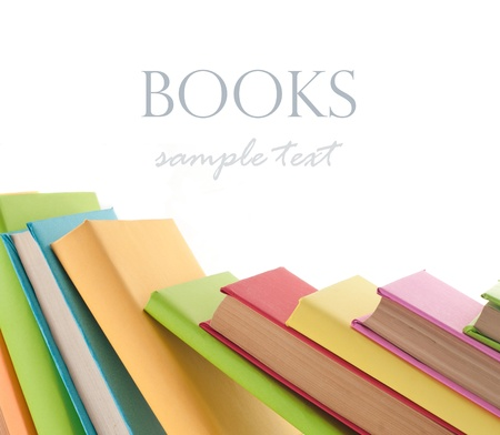 Many colorful books in a row creating a border frame. Isolated on white.  photo