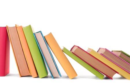 close up of stack of colorful books on white background