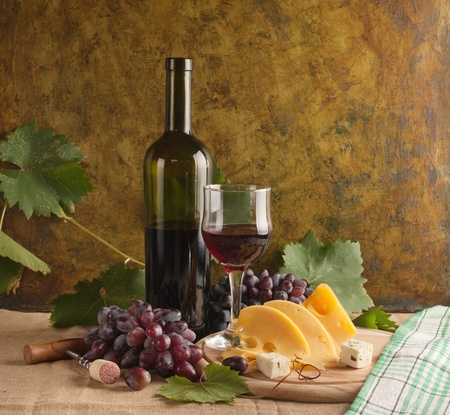 cabernet sauvignon: Red wine glass on vintage a background