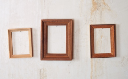 wooden photo frame on old wall  photo