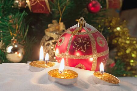 Burning candles in a Christmas setting with seasonal decorations Stock Photo - 10942069