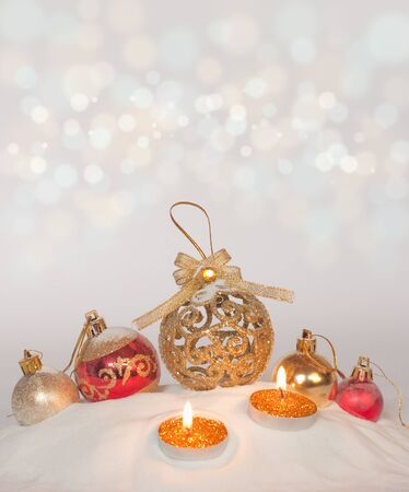 Burning candles in a Christmas setting with seasonal decorations  photo