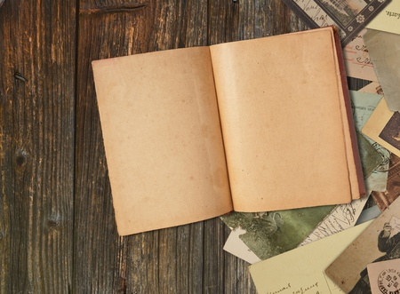 Vintage book on wooden background  photo