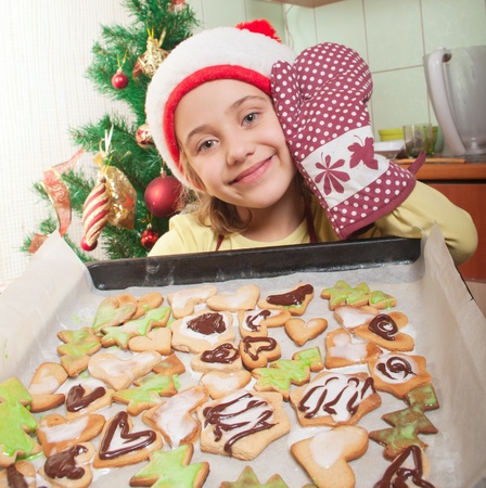 Little girl baking christmas cookies Stock Photo - 11548267