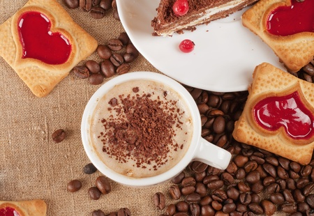 Close-up of cup of coffee and chocolate cake  photo
