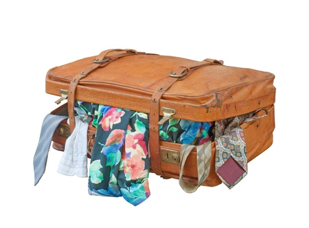 open suitcase: Old leather suitcase overstuffed  Stock Photo