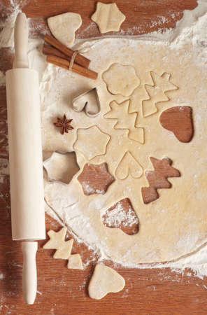 Christmas baking background with dough, spices and cookie cutters photo