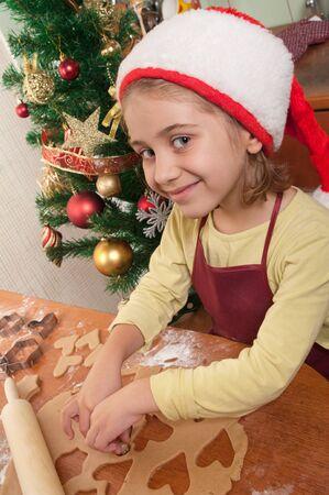 Little girl baking Christmas cookies  photo