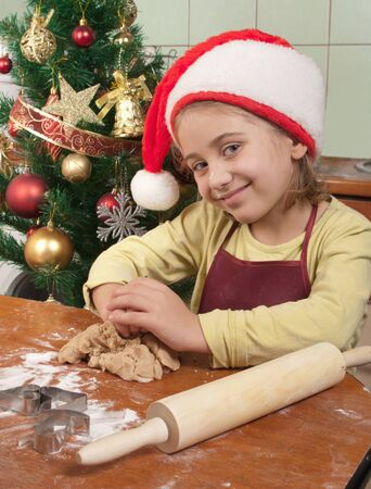 Little girl baking Christmas cookies  photo