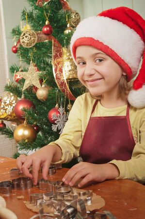 christmas cooking: Little girl baking Christmas cookies  Stock Photo