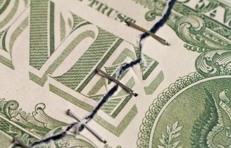 avidity: torn dollar bound by a stapler