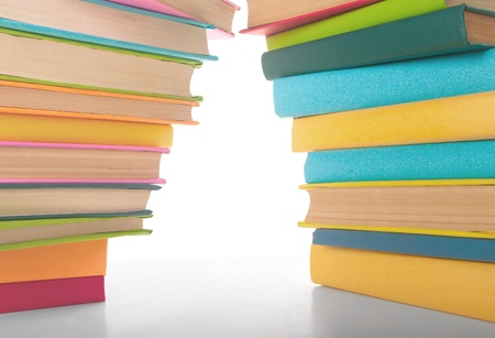 close up of stack of colorful books on white background Stock Photo - 11548290