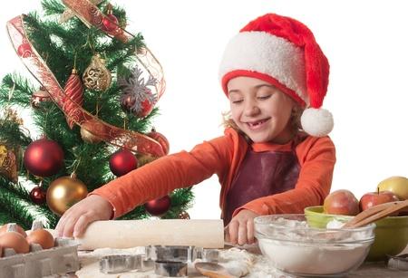 Merry Christmas - little girl baking Christmas cookies  photo