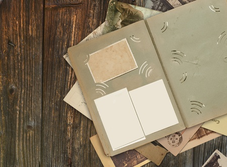 antiquary: the old album on wooden background